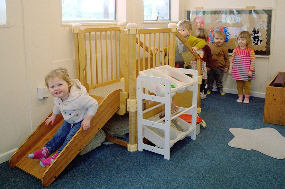 Willow Park Hedgehogs children playing on a slide